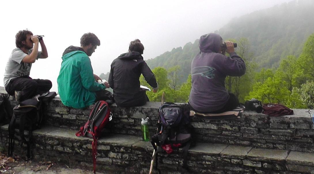 Projects Abroad volunteers are pictured taking a break and looking through binoculars during their conservation work in the Himalayas in Nepal.